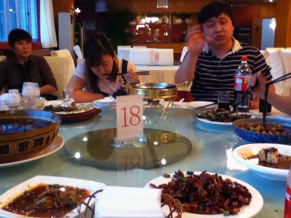 Eating in Shenyang after arriving with my friendss and friendss of theirs.  The food was delicious!  The world is so much more than beans.
